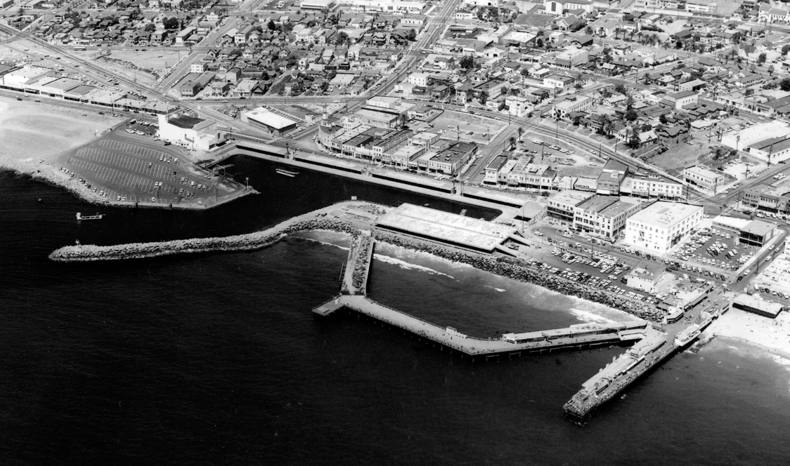 Aerial view of Monstad Pier and Horseshoe Pier. 1940's